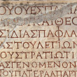 Old greek scriptures in Ephesus Turkey - Stock Photo