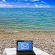 Netbook on beach — Stock Photo