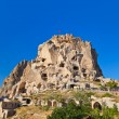Uchisar Castle in Cappadocia Turkey - Stock Photo