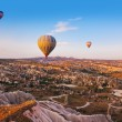 Hot air balloon flying over Cappadocia Turkey — Stock Photo #23003850