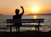 žena a západ slunce — Stock fotografie