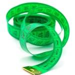 Green measuring tape — Stock Photo