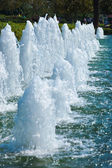 Fountain water jets in park — Stock Photo