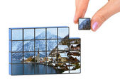 Hand and winter Austria (my photo) puzzle — Stock Photo