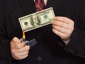 Hands and burnning money — Stock Photo