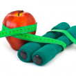 Apple and dumbbells — Stock Photo