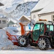 Tractor blower cleaning snow in street — Stok fotoğraf