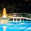 Water pool and fountain at night — Stock Photo #33470659