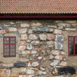 Windows in stone wall — Stock Photo