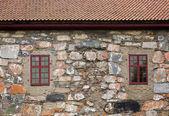 Windows in stone wall — Stock Photo