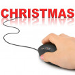 Hand with computer mouse and Christmas — Stock Photo #35704195