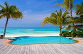 Pool on a tropical beach — Stock Photo