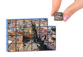 Hand and Sevilla Spain (my photo) puzzle — Stock Photo