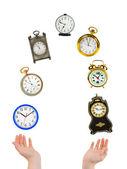 Jonglering händer och klockor — Stockfoto