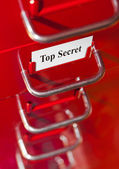 Red file cabinet with card Top Secret — Stock Photo