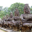 Stock Photo: Angkor Thom (ancient royal city) entrance bridge with row of dem