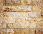 Seamless yellow facing stone masonry texture. — Stock Photo