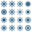 Stock Vector: Set of snowflake shapes isolated on white background.
