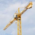 Yellow stationary hoist crane in sunlight. — Stock Photo