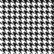 Seamless black and white houndstooth vector pattern. — Stock Vector