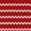 Seamless red and white knitted vector pattern. — Stock Vector