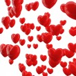 Red hearts on white background. — Стоковое фото