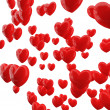 图库照片: Red hearts on white background.