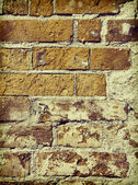 Vintage stylized old brick all close-up background. — Стоковое фото