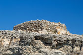Ancient stone talayot at Menorca island, Spain. — Stock Photo
