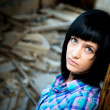 Girl in a destroyed building — Stock Photo