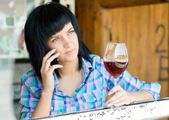 The young girl with a wine glass — Stockfoto