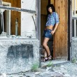 Sexual girl near the destroyed house — Stock Photo