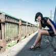Thoughtful girl on a bridge — Stock Photo