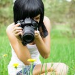 The girl photographs a dandelion — Stock Photo