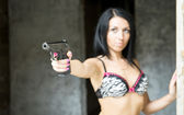Sexy girl with gun — Stock Photo