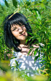 Beautiful girl in green foliage — ストック写真