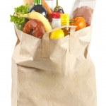 白い背景の上に食べ物が入った紙袋 — ストック写真