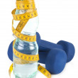Two dumbells, water in bottle — Stock Photo