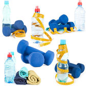 Set of dumbells, water in bottle and towel on white background — Photo