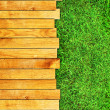 Wooden board on grass  — Stock Photo