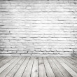 Vintage room with brick wall and wooden floor — Stock Photo #36068857