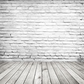 Vintage room with brick wall and wooden floor — Stock Photo