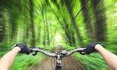 Mountain biking down hill — Stock Photo