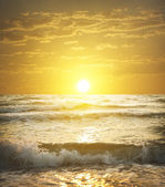 Sunset over the water on sea — Stock Photo