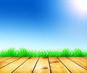 Färsk våren grönt gräs och solljus och trä golv — Stockfoto