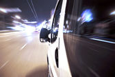 Driving in the night — Stockfoto