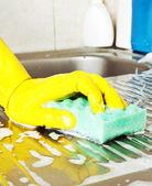 Hand with sponge — Stock Photo