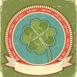 Clover label on grunge old paper background with scroll for text - Stock Vector