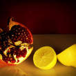 Still life with red pomegranate and lemon.Fruits background — Stock Photo