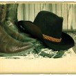 Vintage western background with cowboy hat on old paper for text — Stock Photo